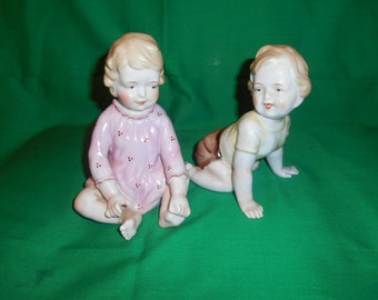 Two (2), Porcelain Piano Baby's,. from Maruyama, of Japan. Circa 1950's.