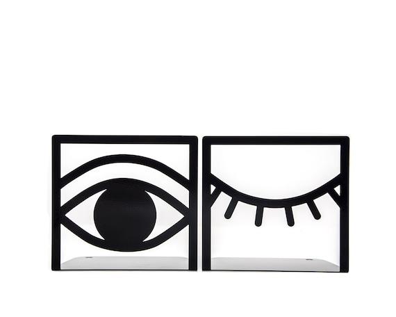 une paire de serre livres un il ferm un oeil ouvert. Black Bedroom Furniture Sets. Home Design Ideas