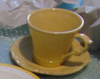 yellow cup and saucer baroque ceramic