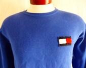 vintage 90's Tommy Hilfiger solid blue fleece designer graphic sweatshirt unisex crew neck pullover jumper embroidered applique logo medium