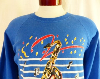 vintage 80's New Orleans Jazz Music blue fleece graphic sweatshirt crew neck raglan saxophone musical notes confetti stripe logo print XL