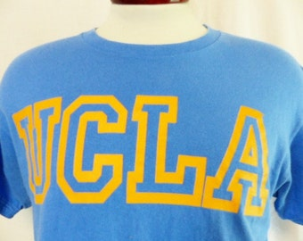 GO UCLA Bruins vintage 90's UCLA University of California Los Angeles sky blue graphic t-shirt yellow gold block letter outline logo medium