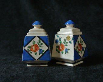 Vintage Hand Painted Salt and Pepper Shakers. Made in Japan.