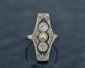 A rare Belle Epoque Basra pearl and 1.36 Ct diamond platinum panel ring