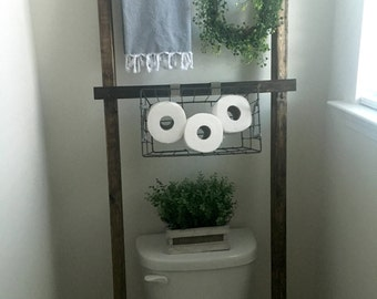 Ladder behind toilet