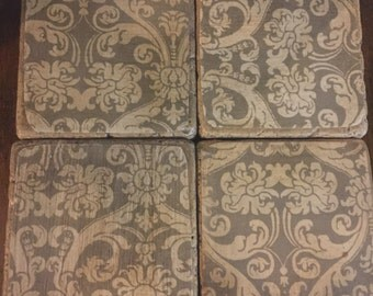 Set of four antiqued tumbled marble coasters