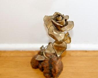 Vintage art brass flower on wood base…signed by artist…1980.