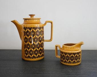 Matching Hornsea tea coffee pot and creamer mustard gold with black mid mod retro design