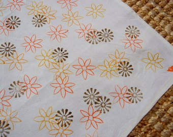Cotton tea towels hand block printed with 2 flowers design in orange/yellow/ochre