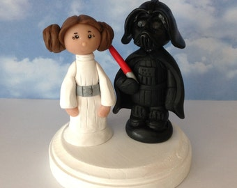 polymer clay cake topper, Darth Vader and Princess Leia, inspired by Star Wars.