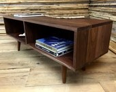 Cameron mid century modern coffee table with storage, featuring black walnut with tapered spindle legs.
