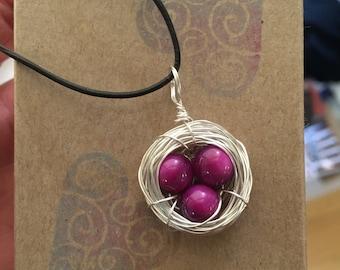 Fuchsia Eggs in a Silver Nest Necklace