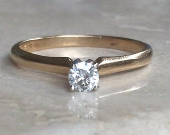 Gorgeous Magic Glo 14k Round Diamond Solitaire Engagement Ring Sized between a 6.75 - 7 Weighing 2 grams