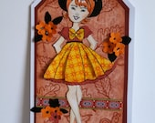 Julie Nutting Paper Pieced Doll Tag or Topper - Girl in Orange and Black