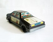 Renault 12 vintage tin toy police car, Turkish. 1970s R12 sedan 12 TS. Cops highway patrol. Black & white tinplate metal litho. Collectible