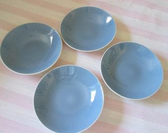 Four pale blue soup bowls (4)