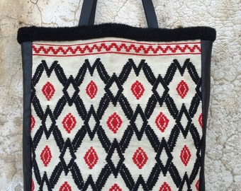 One of two, (and then they are gone...) great folk embroidery, sewn together with soft italian calfskin.