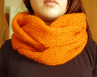 Knitting orange infinity scarf Autumn