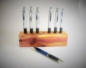 Juniper wood pen holder.