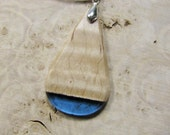 Bulbous blue teardrop wood resin fusion pendant. Translucent blue resin and maple wood pendant. All natural UVpoxy.