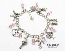 Bracelet charms; Swallows, hearts, gun, tree, book and train with pink glass beads, inspired by the saga Divergente, Teenager gift