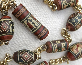 Peruvian hand painted terra-cotta bead necklace with Inca designs, vintage