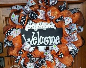 Fun Halloween orange, black and white ghost welcome wreath