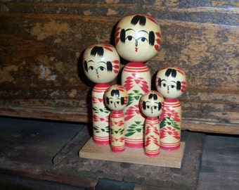 Vintage Travel Souvenir Wooden Handpainted Asian Family of Five Figurine Set