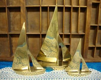 A Trio of Three Brass Sailboats