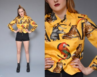 90s SARFARI printed silk blouse // colorful golden yellow African  jungle animal novelty printed button up collared dress shirt crop blouse