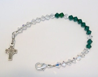 Celtic cross bracelet. Green and clear Swarovski crystal beads. Silver plated cross and clasp.
