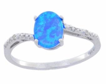 14Kt White Gold Blue Opal & Diamond Oval Ring