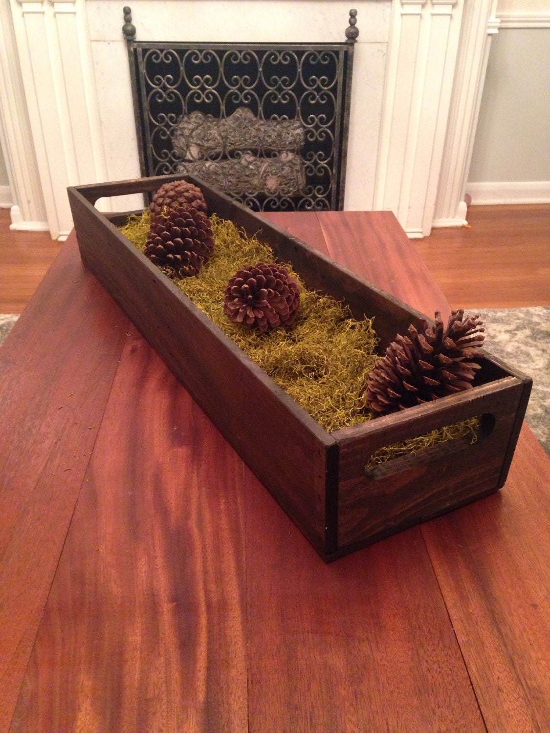 Long reclaimed dark stained wood tray table centerpiece