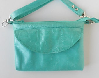 Leather crossbody bag, leather sling bag, in pearlized turquoise blue.