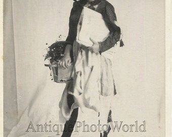 Cute girl w flower basket dressed as a vagabond antique photo