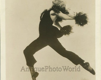 Beautiful woman dancer caught in a jump antique photo