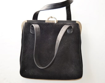 retro black leather bag with silver closure