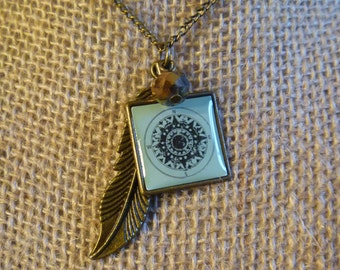 Brass compass feather charm necklace