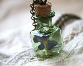 Green bottle pendant, terrarium necklace, flower necklace, botanical pendant, pansy pendant, nature necklace, made in Canada