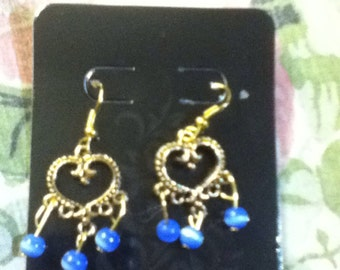 Gold heart earrings with blue glass beads