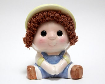 Vintage ceramic boy money-box with wool hair detail.