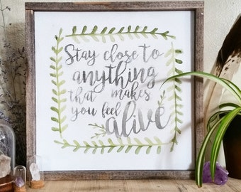 Stay close to anything that makes you feel alive. Reclaimed wood sign