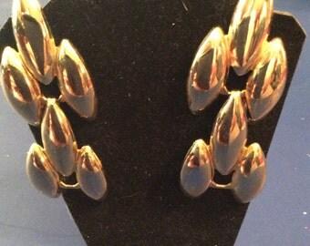 Gold toned pierced earrings 2-1/2 in