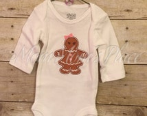 CLEARANCE SALE 50% off Newborn Sized Long Sleeve Onesie with Gingerbread Girl  on chest.