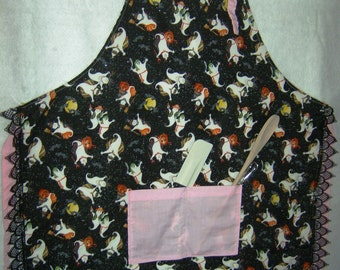 Ghost apron with pink trim and black lace with cooking utensils