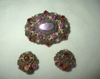 Vintage rhinestone brooch and earrings set ruby red with goldtone iridescent