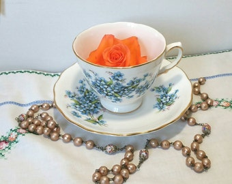 Vintage Royal Vale tea cup and saucer made from bone china in the 1950's with blue forget me not pattern.