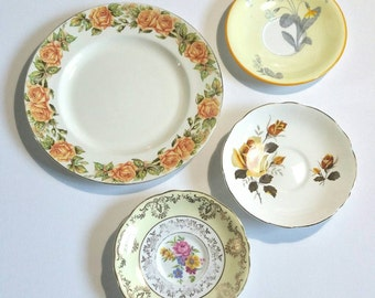 Vintage decorative wall plates in shades of yellow. Set of four including royal doulton coronet ware and aynsley plates all 1950s.