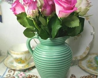 Vintage English earthenware Winalex Ware blue glazed jug.