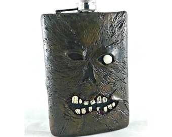 Necronomicon Ex Mortis Flask with glow in the dark eye, Evil Dead 8 oz Flask